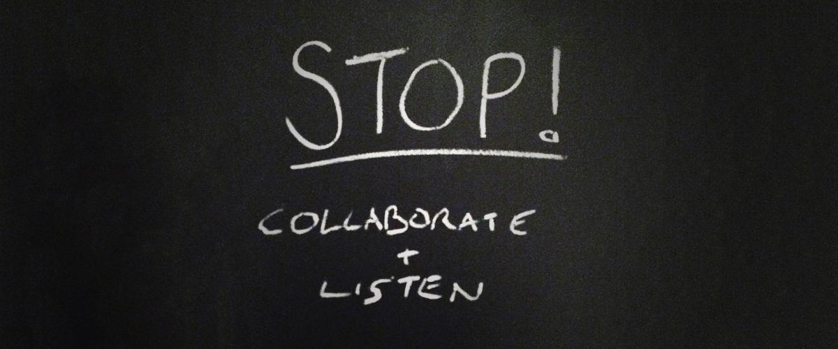 Stop, collaborate and listen written on blackboard